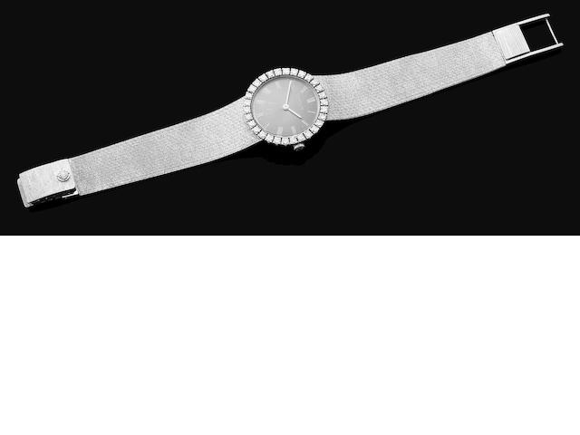 A lady's gold and diamond bracelet watch by Patek Philippe,