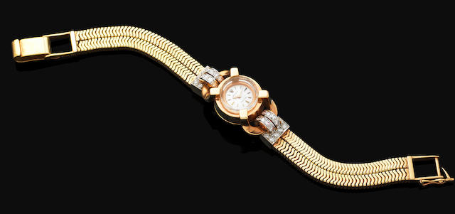 A lady's diamond bracelet watch by Rolex,