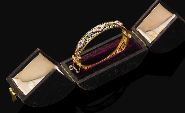 An antique enamel, pearl and ruby bangle,  by Carlo Giuliano,