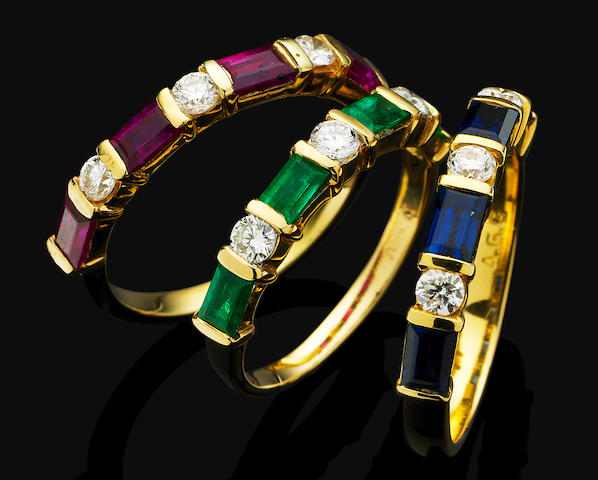 A set of three multi-gem and diamond rings