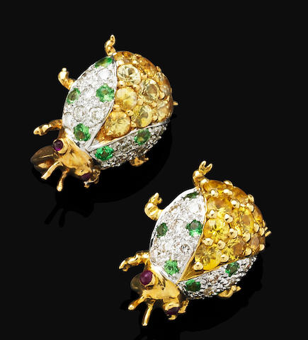 A pair of gem-set brooches