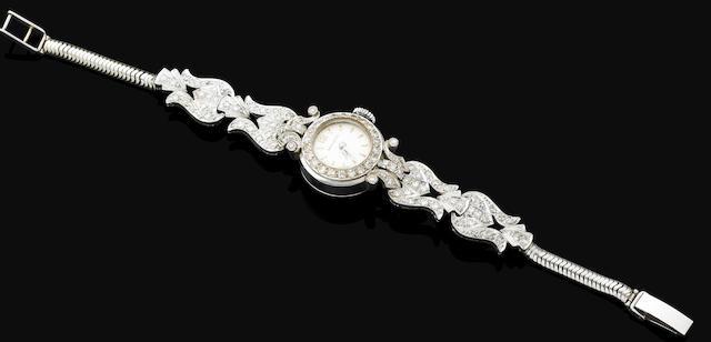 A lady's gold and diamond bracelet watch by Movado,