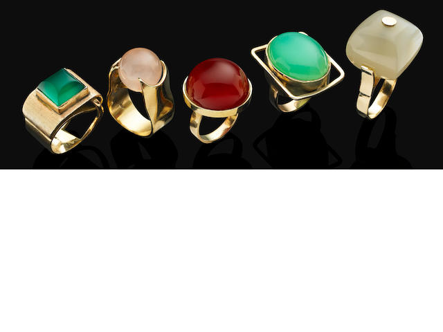 A group of multi-gem cocktail rings
