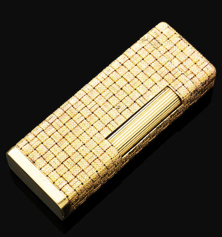 A gold lighter, by Dunhill