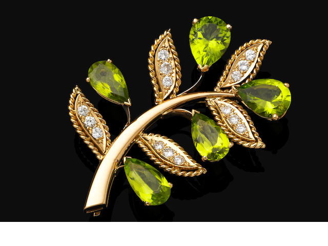A peridot and diamond brooch, by Van Cleef & Arpels,