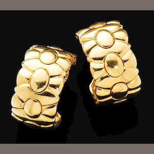 A pair of gold earrings, by Cartier,