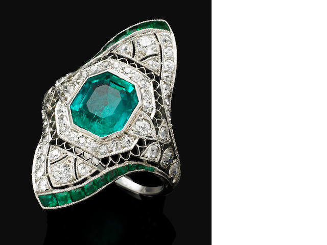 A Belle Epoque emerald and diamond ring,