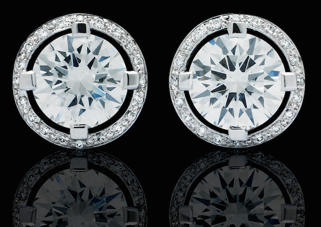 A pair of diamond earrings, by Canturi