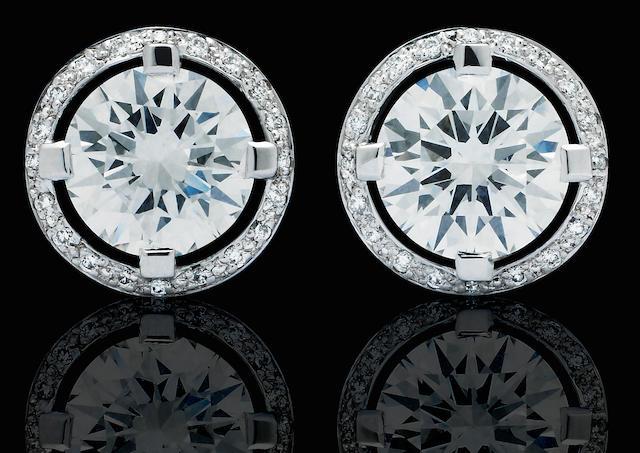 A pair of diamond earrings, by Canturi