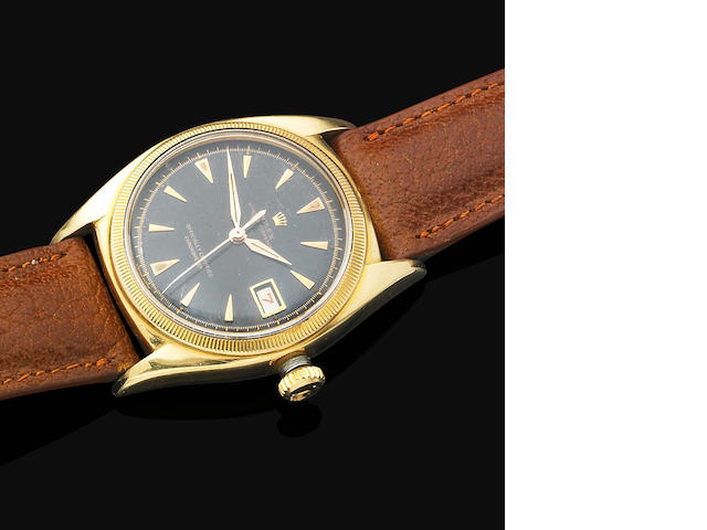 A fine 18ct gold calendar wristwatch by Rolex