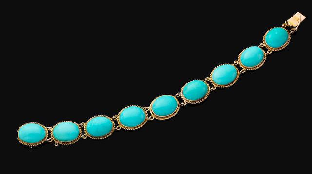 A turquoise bracelet,