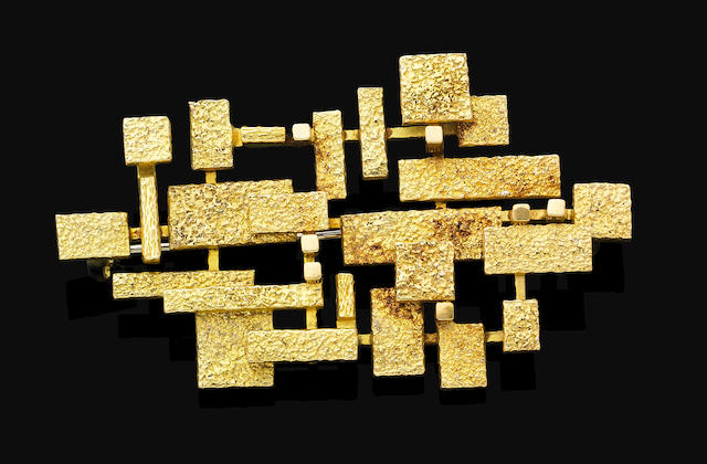 A gold brooch,