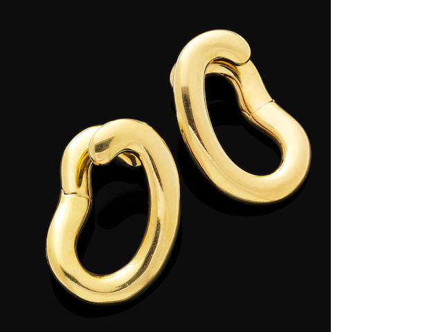 A pair of gold earrings, by Pomellato
