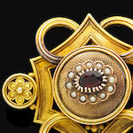 An antique gold and gem-set brooch,