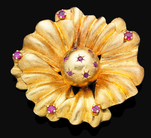A ruby-set cocktail brooch,