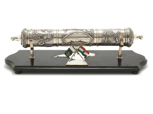 A mid 20th century Indian metalware scroll holder on stand apparently unmarked, circa 1940