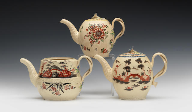 Two teapots with covers and one without