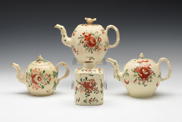 Three enamelled teapots and covers and a tea canister