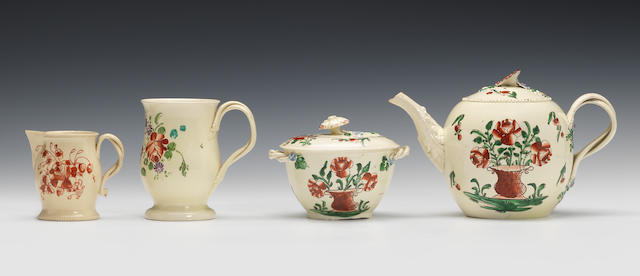 A Cockpit Hill creamware teapot and cover, a sucrier and cover, a mug and a sparrow beak jug, circa 1770