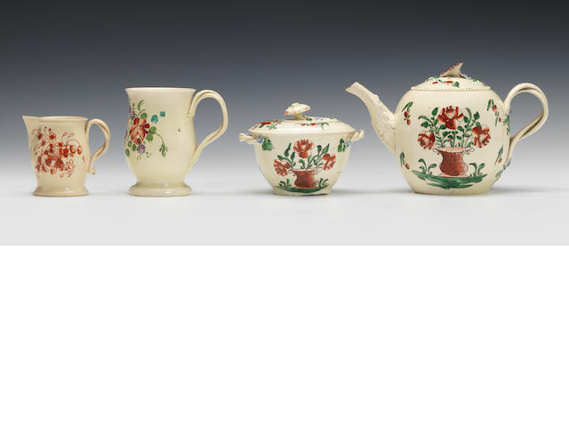 Flower painted teapot and cover, a sucrier and cover, a mug and a sparrow beak jug
