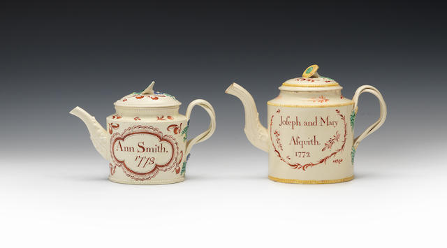 Two inscribed teapots and covers