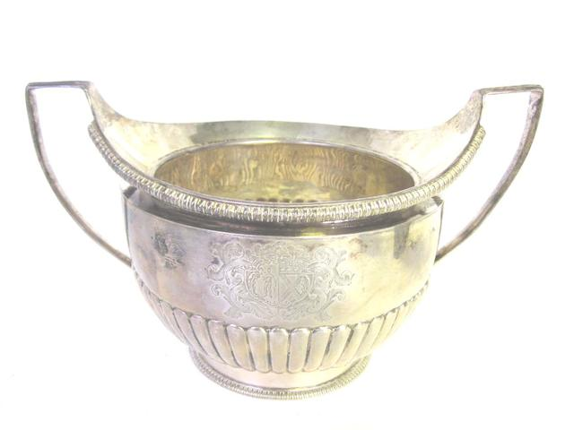 A large George III silver two-handled sugar bowl by Richard Cooke, London 1806; together with two swing handle cream pails and a cream jug  (4)