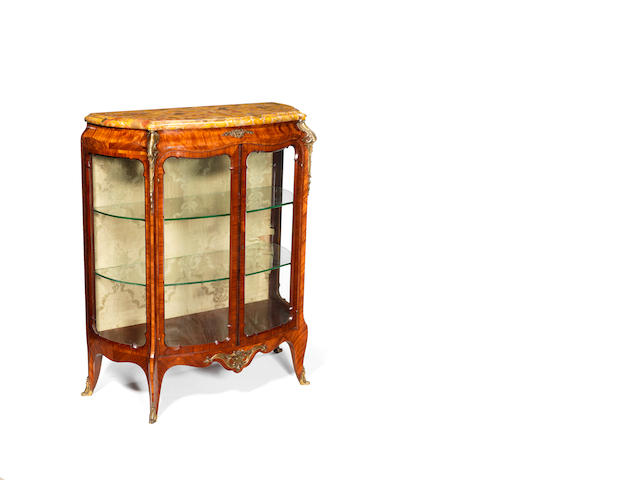 A French late 19th/ early 20th century Louis XV style ormolu-mounted kingwood and satiné vitrine-cabinet