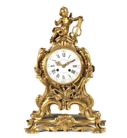 A French late 19th century Louis XV style gilt bronze clockafter an 18th century model by Robert Osmond