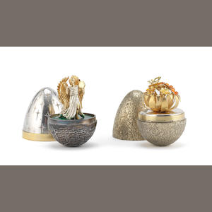 STUART DEVLIN: Two silver, silver and enamelled novelty surprise eggs  (2)