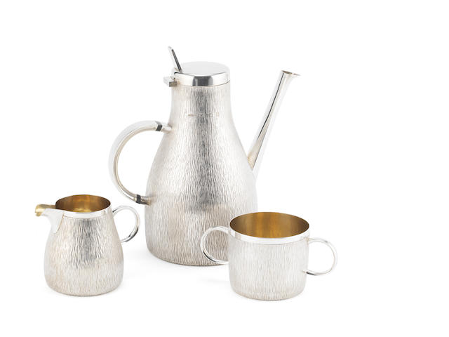 GERALD BENNEY: A  silver three-piece coffee service London 1967, the cream jug 1969, also stamped GERALD BENNEY LONDON, together with a bowl and spoon, by Gerald Benney, London 1967,  (5)