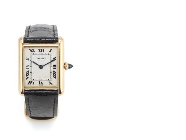 CARTIER: A 18 carat gold cased tank wristwatch with deployant buckle signed and numbered 780865903 case back, with 18 carat gold common control mark