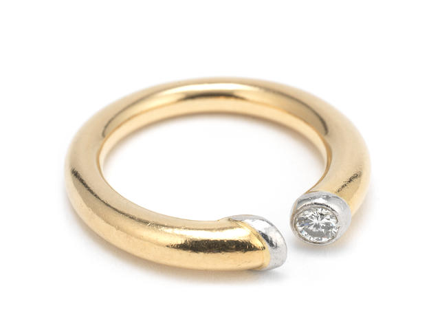 An unmarked gold and diamond set 'commitment range' ring by Hennell's of New Bond Street, incuse mark HBS, designed by chief designer Dennis Gardner