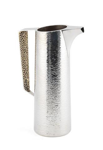 STUART DEVLIN: A good silver and silver-gilt water pitcher London 1977
