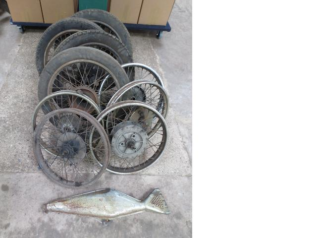 Assorted wheels and a Velocette fishtail silencer,