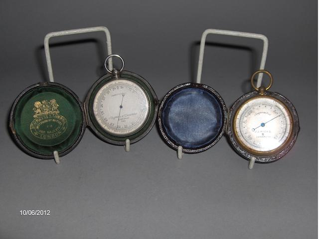 A Negretti and Zambra gilt metal pocket barometer and case, together with another by JJ Hicks London