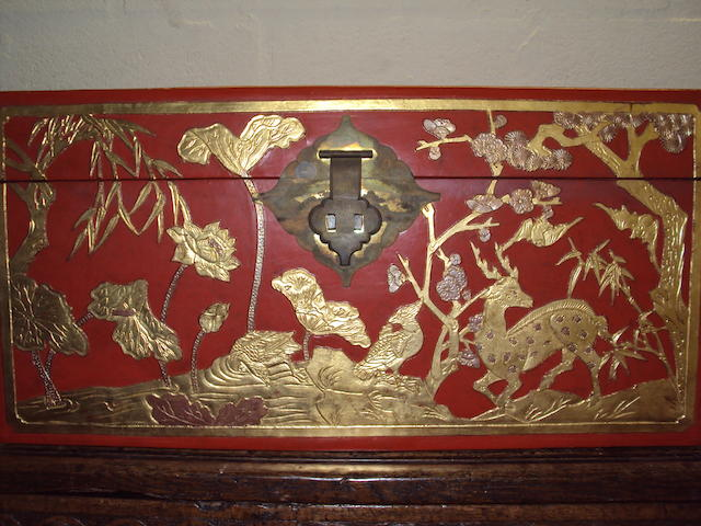 A scarlet lacquered and gilt dowry chest
