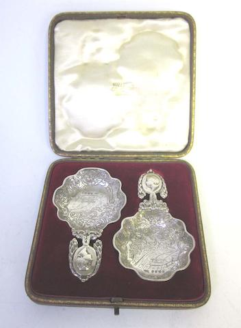 A cased pair of 19th century Dutch silver wine tasters with Dutch export and standard marks, and additional pseudo marks, 1897, also with import marks for Samuel Bouce Landeck, Sheffield 1896/7  (2)