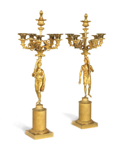 A pair of French late 19th century Empire style gilt-bronze six-light figural candelabra
