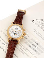 Patek Philippe. A very fine and rare 18ct gold manual wind perpetual calendar split seconds chronograph wristwatch with moon phases and Certificate of Origin Ref:5004, Case No.2984901, Movement No.879513,