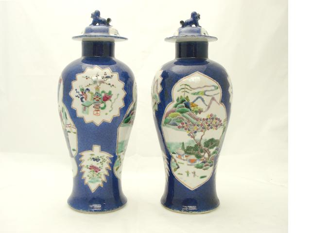 A pair of powder blue ground vases with covers Bearing Kangxi marks but late 19th century