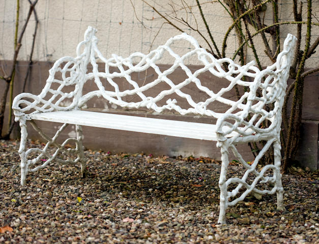A pair of late 19th century wrought iron garden benches