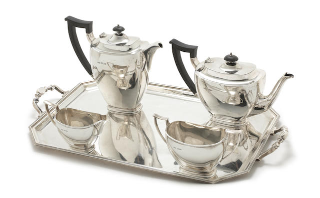 A four-piece silver tea service with matched two-handled tray the tea service, by James Dixon & Sons, the tray, by William Suckling Ltd, Sheffield 1945-46
