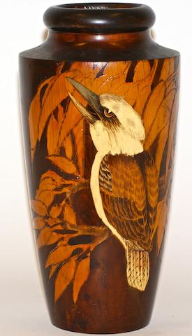 An Australian pokerwork vase decorated with a kookaburra amongst gum leaves