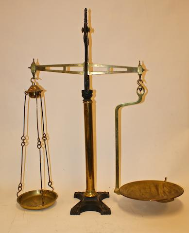 A large pair of cast iron and brass balance scales