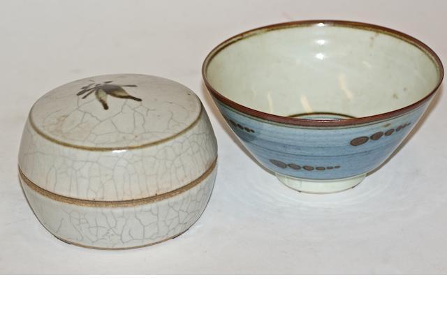 A crackled celadon glazed earthenware lidded pot