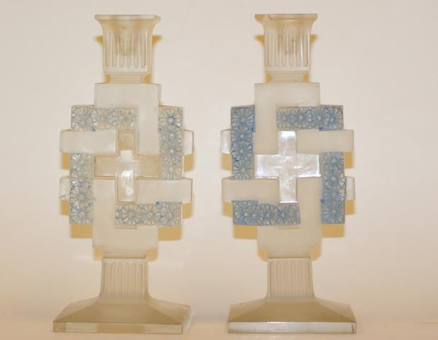 """Paquerettes"" A pair of Rene Lalique clear, frosted, blue-stained candlesticks"