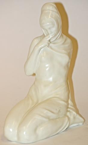 (Pick Type of Doulton) 'Salome' A Doulton & Co figure of a kneeling cowled girl
