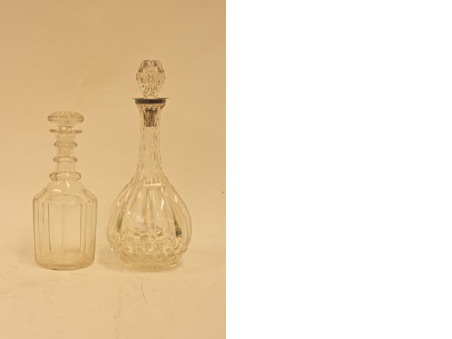 A Regency cut glass decanter with three ring neck and mushroom stoppers