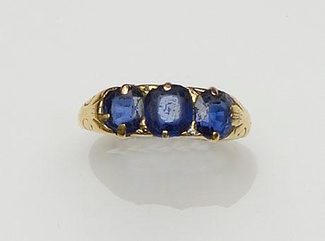 A sapphire three stone ring