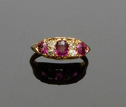 A ruby and diamond half hoop ring